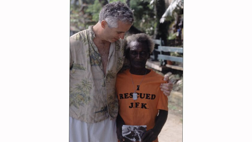 Max Kennedy, nephew of President Kennedy, visits Eroni Kumana, right, in November 2002 in the Solomon Islands.