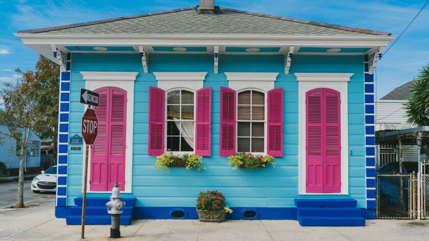 One of the brightly colored shotgun houses in New Orleans. Courtesy of New Orleans CVB