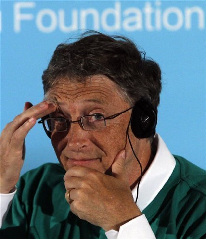 Microsoft founder Bill Gates reacts during a press conference to promote public health and a smoke free environment in Beijing, China, Saturday, June 11, 2011. (AP Photo/Ng Han Guan)