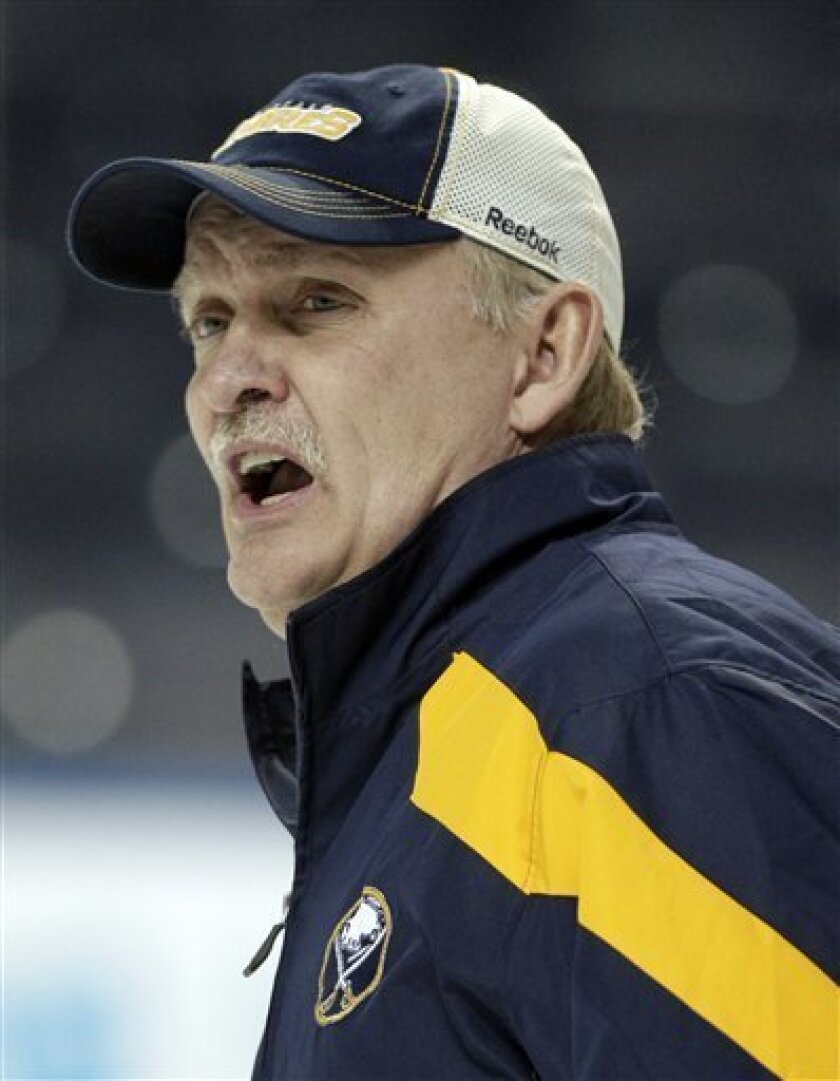 FILE - In this Jan. 11, 2012, file photo, Buffalo Sabres coach Lindy Ruff talks with players during NHL hockey practice in Buffalo, N.Y. Ruff was fired on Wednesday, Feb. 20, 2013, after the team's latest slow start to the season and amid growing criticism from the team's fan base. (AP Photo/David