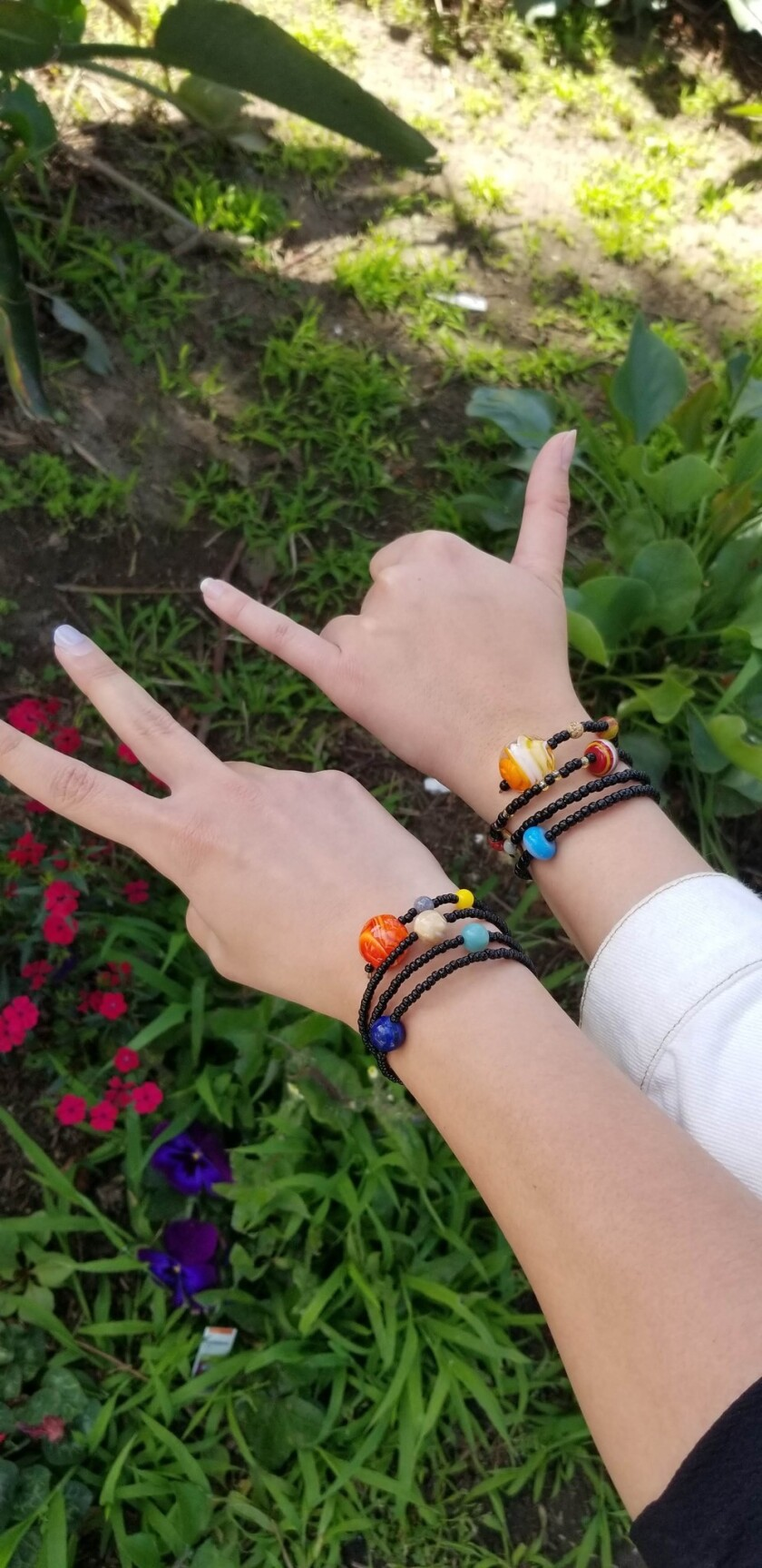 (Left) The Solar System bracelet currently for sale; (right) the original Solar System bracelet