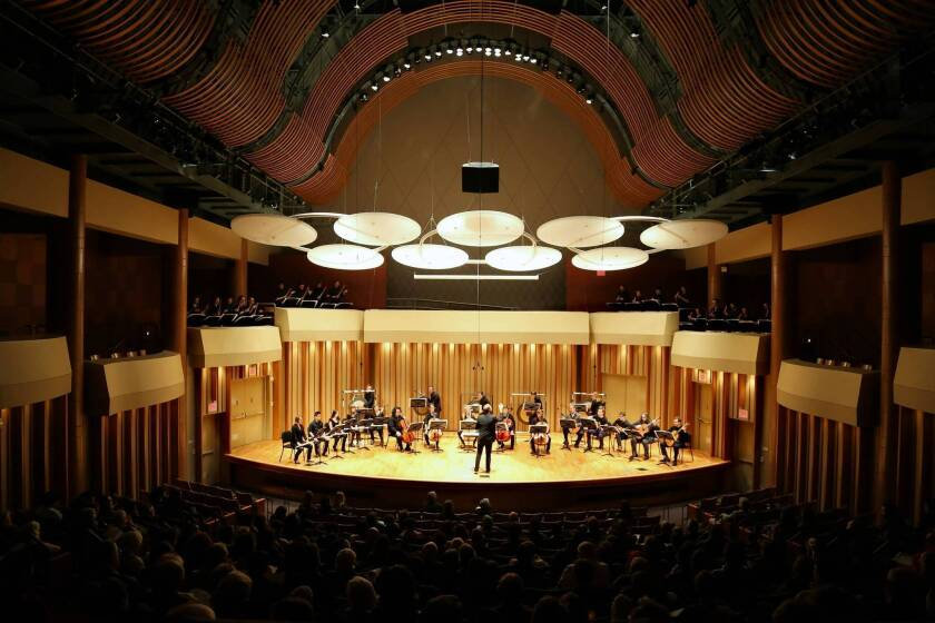"""Christopher Rountree conducts the ensemble performing """"Strata"""" by composer Jose Maceda at the Monday Evening Concerts in Zipper Concert Hall at the Colburn School."""