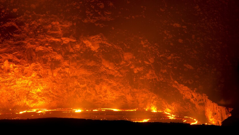 A growing lake of molten lava within the crater of Kilauea volcano is drawing large crowds to Hawaii Volcanoes National Park.