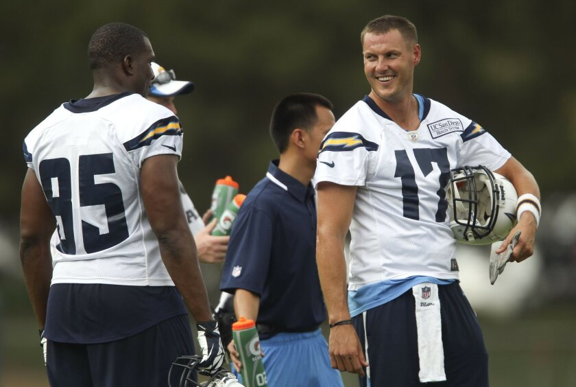 Next year, HBO cameras could be picking up what Chargers quarterback Philip Rivers, right, and tight end Antonio Gates are talking about during training camp.