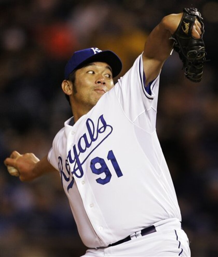 In this April 10, 2008, file photo Kansas City Royals pitcher Hideo Nomo (91) pitches to New York Yankees' Alberto Gonzalez during the seventh inning of a major league baseball game in Kansas City, Mo. The 39-year-old right-hander, who made his first major league debut with the Dodgers in 1995, has decided to call it quits after an illustrious career that included two-no hitters in the MLB, Japan's Kyodo News service reported on Thursday July 17, 2008. (AP Photo/Orlin Wagner, FILE)