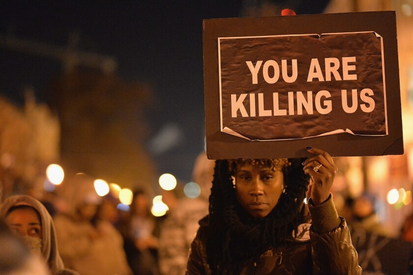 Demonstrators participate in a peaceful protest in St. Louis' Central West End neighborhood a day after a grand jury decided not to indict a white police officer in the shooting death of Michael Brown.