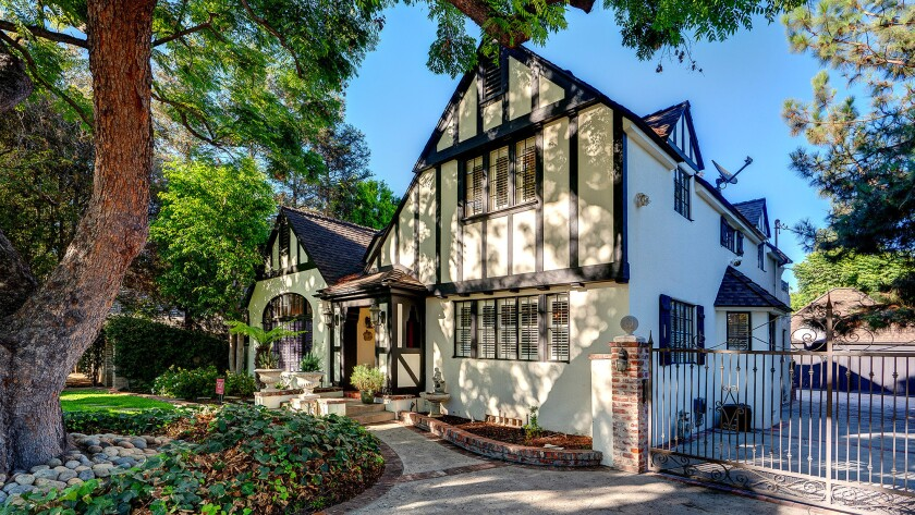 The Home of the Week in Alhambra, built in 1927, remains a prime example of the English Tudor Revival style.