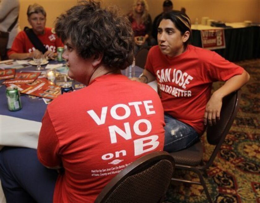 Campaign worker Nate Neuenschwander, left, watches election returns at a campaign party for No on Measure B in San Jose, Calif., Tuesday, June 5, 2012. As state and local governments across the country struggle with ballooning pension obligations, voters in two major California cities cast ballots Tuesday on sweeping measures to curb retirement benefits for government workers. San Jose Mayor Chuck Reed, a Democrat, joined an 8-3 City Council majority to put San Jose Measure B on pension reform on the ballot. (AP Photo/Paul Sakuma)
