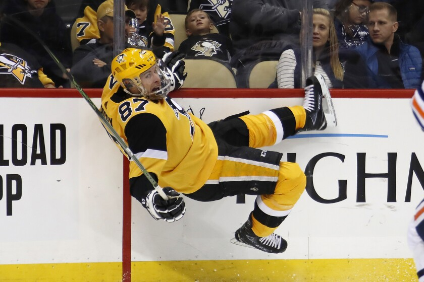 Pittsburgh Penguins' Sidney Crosby is knocked off his skates by Edmonton Oilers' Oscar Klefbom during the second period of an NHL hockey game in Pittsburgh, Saturday, Nov. 2, 2019. (AP Photo/Gene J. Puskar)