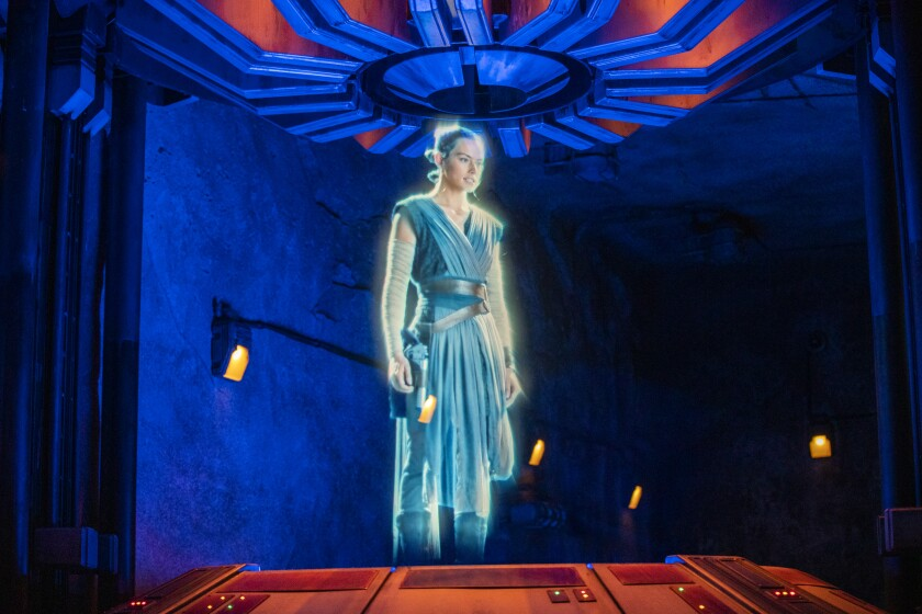 A Rey hologram materializes during the media preview of Star Wars: Rise of the Resistance at the Disneyland Resort