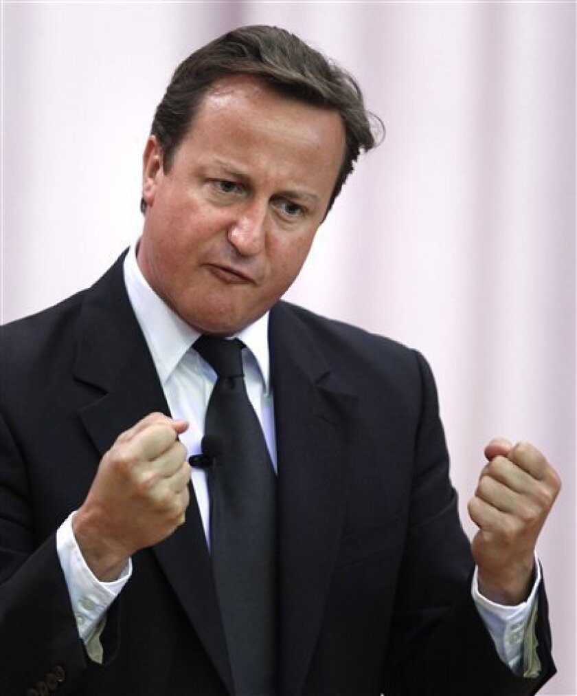 Britain's Prime Minister David Cameron gestures as he addresses students of Moscow State University (MGU) in Moscow, Russia, Monday, Sept. 12, 2011. Cameron insisted Monday that Russia and Britain can overcome sharp differences in their relations - including the 2006 poisoning death of a Kremlin critic in London - to seal new trading ties and help promote world stability in the wake of the Arab Spring. (AP Photo/Mikhail Metzel)