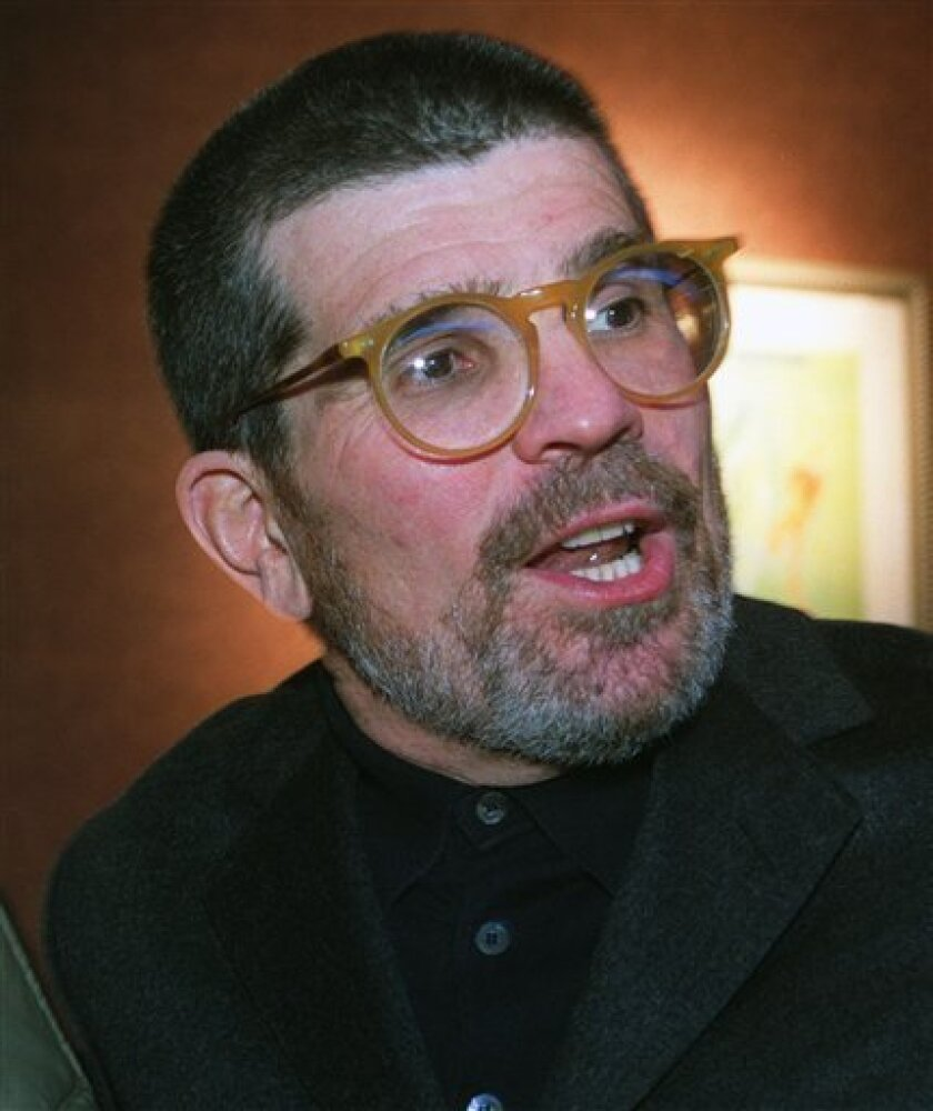 """FILE-This Dec. 4, 2000 file photo shows David Mamet arriving at the opening of the movie """"State and Main,"""" in New York. Producer Jeffery Richards, Jerry Frankel and Steve Traxler say a revival of Mamet's """"A Life in the Theatre"""", will open this fall in New York. (AP Photo/Tina Fineberg, file)"""