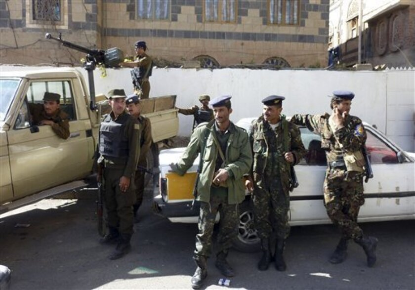 Yemeni policemen stand alert outside the state security court in San'a, Yemen, Tuesday, Nov. 9, 2010 where the US-born radical cleric Anwar al-Awlaki is being tried in absentia for inciting killing of foreigners. Al-Awlaki, believed to be hiding in Yemen, was linked to last year's shooting at Fort Hood, Texas, and the attempted bombing of a U.S.-bound flight last Christmas. In the latest video, he said all Americans are the enemy and Muslims should kill any of them at will without consulting anyone. (AP Photo)