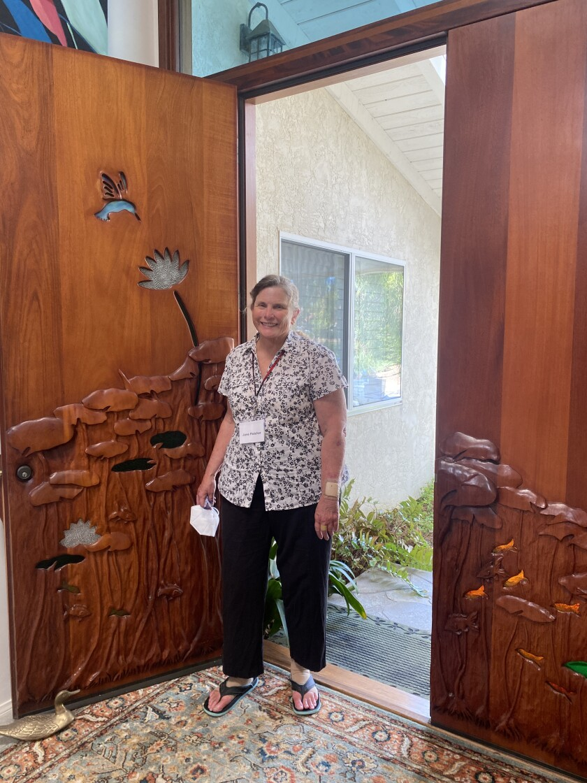 La Jolla artist Jane Fletcher shows her front doors, which she carved.
