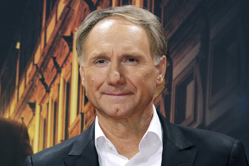 """FILE - In this Oct. 10, 2016 file photo, author Dan Brown arrives for the premiere of the movie """"Inferno"""" in Berlin. Blythe Brown, the author's ex-wife, filed a lawsuit Monday, June 29, 2020, in New Hampshire alleging he led a secret life during their marriage that included several affairs. The pair divorced in 2019 after 21 years of marriage. (AP Photo/Markus Schreiber, File)"""