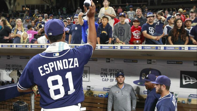 SAN DIEGO , October 7, 2016   The Padres pitcher Anderson Espinoza tosses a ball he just autographe