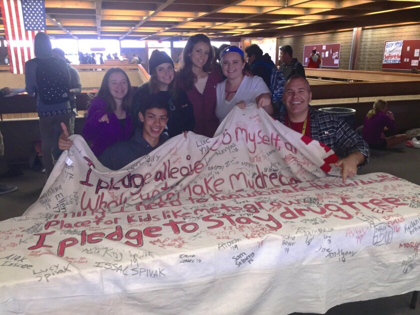 Don Collins and PALS students had TPHS students sign the pledge to stay drug free.