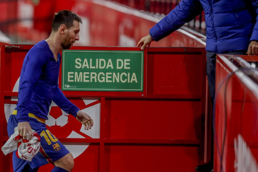 Barcelona's Lionel Messi leaves the pitch at the end of the Spanish Copa del Rey semifinal soccer match between Sevilla and FC Barcelona at Ramon Sanchez Pizjuan stadium in Seville , Spain, Wednesday, Feb. 10, 2021. (AP Photo/Angel Fernandez)