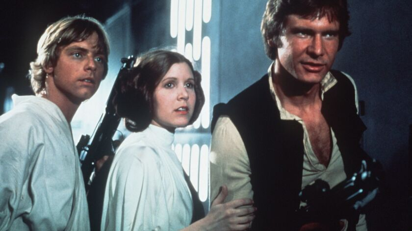 20030817 (LA/E6) ññ `STAR WARS': Mark Hamill, left, Carrie Fisher and Harrison Ford in one of the