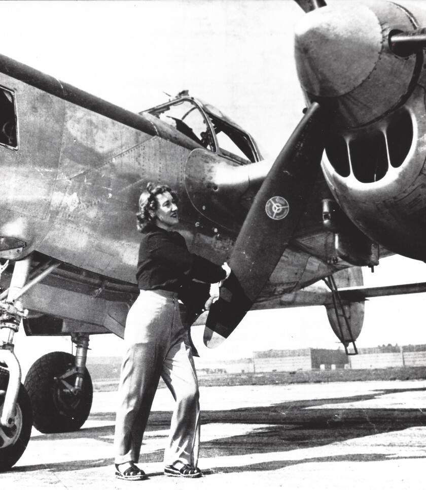 March 1946: Pilot Nadine Ramsey, admiring her new P-38 fighter plane in March 1946.