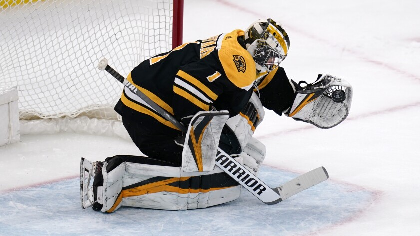 Boston Bruins goaltender Jeremy Swayman makes a glove save on a shot by Buffalo Sabres right wing Tage Thompson during the shootout in an NHL hockey game Tuesday, April 13, 2021, in Boston. The Bruins won 3-2. (AP Photo/Charles Krupa)
