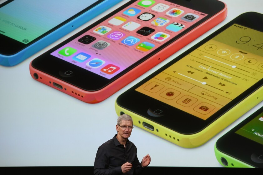 Apple chief Tim Cook unveils the iPhone 5C during an event in 2013 in Cupertino, Calif.