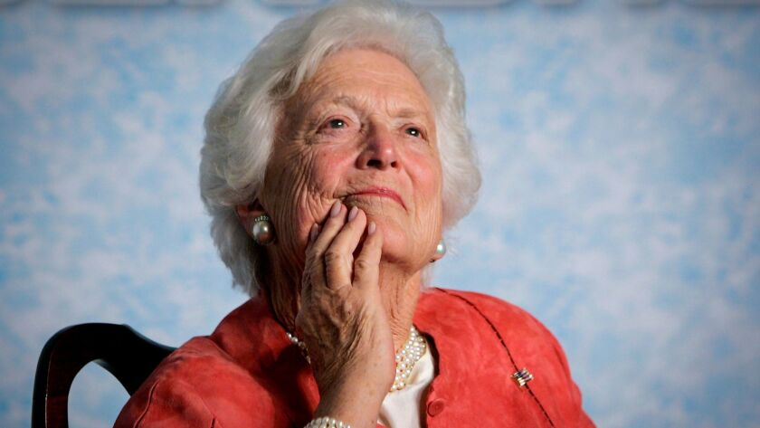 Barbara Bush listens to her son, President George W. Bush, speak in 2005.