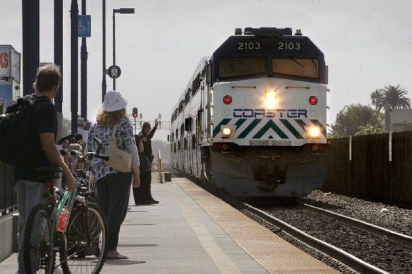 Passengers wait to board a Coaster train at the Oceanside Transit Center. U-T San Diego file photo.