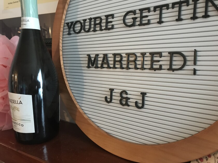 Her sister left this wedding congratulations on the mantel in my daughter's apartment.