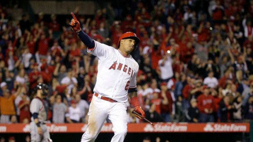 Angels infielder Yunel Escobar celebrates his walk-off single against the Indians during a game on June 11.