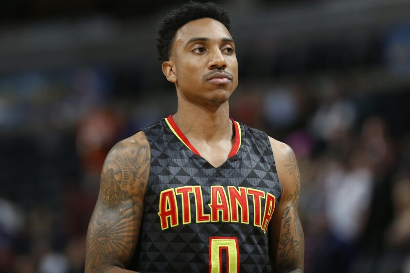 FILE - In this Jan. 25, 2016, file photo, Atlanta Hawks guard Jeff Teague (0) looks on during the first half of an NBA basketball game against Denver, in Denver. The Hawks could look to shake things up and give themselves a boost while sitting in the fourth spot in the Eastern Conference. With back