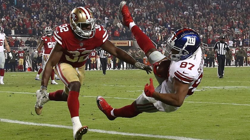 Sterling Shepard (87) of the New York Giants catches a three-yard touchdown against the San Francisco 49ers.
