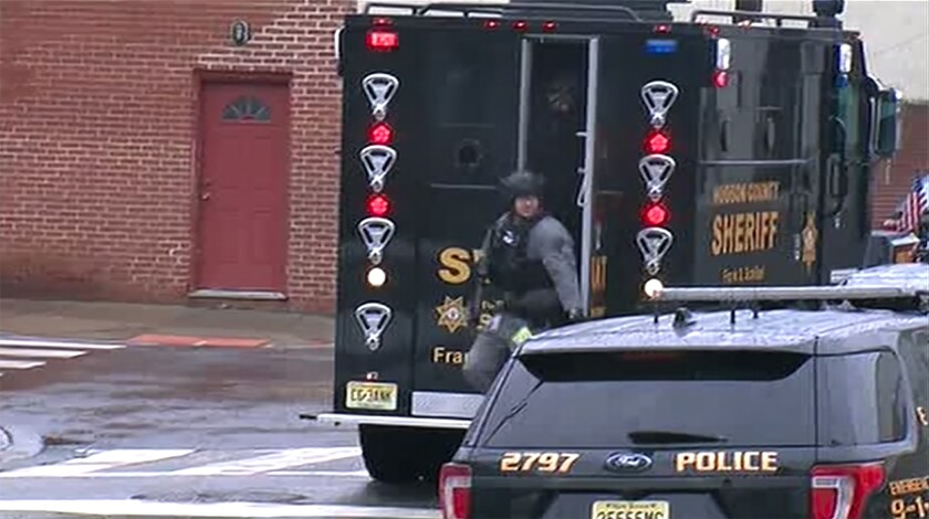 In this image taken from video, Hudson County Swat team officers arrive at the scene following reports of gunfire Tuesday, Dec. 10, 2019, in Jersey City, N.J. (WNYW FOX 5 via AP)