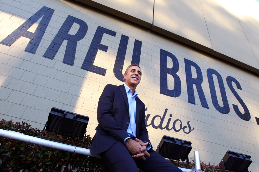 Founder & CEO of Areu Bros.Studios, Ozzie Areu, a Cuban American, in front of their sign at their film studio that was the former home of Tyler Perry Studios in Atlanta, Ga.