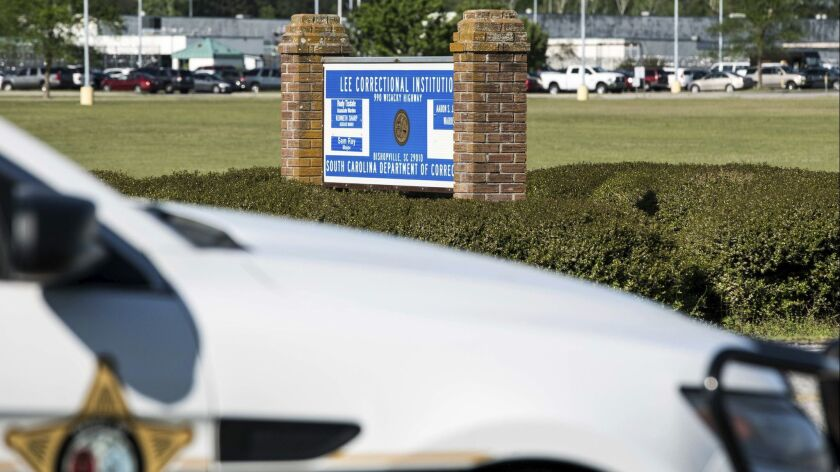 A police vehicle sits outside the Lee Correctional Institution on Monday, April 16, 2018, in Bishopv