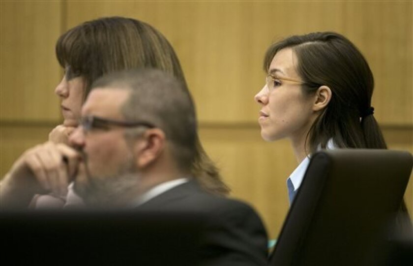 Jodi Arias  listens during her trial at Maricopa County Superior Court in Phoenix on Wednesday, April 10, 2013.   Arias is on trial for the killing of  Travis Alexander, in 2008. (AP Photo/The Arizona Republic, David Wallace, Pool)