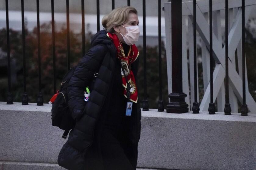 Dr. Deborah Birx, White House coronavirus response coordinator, leaves the White House Tuesday, Dec. 1, 2020, in Washington. (AP Photo/Evan Vucci)