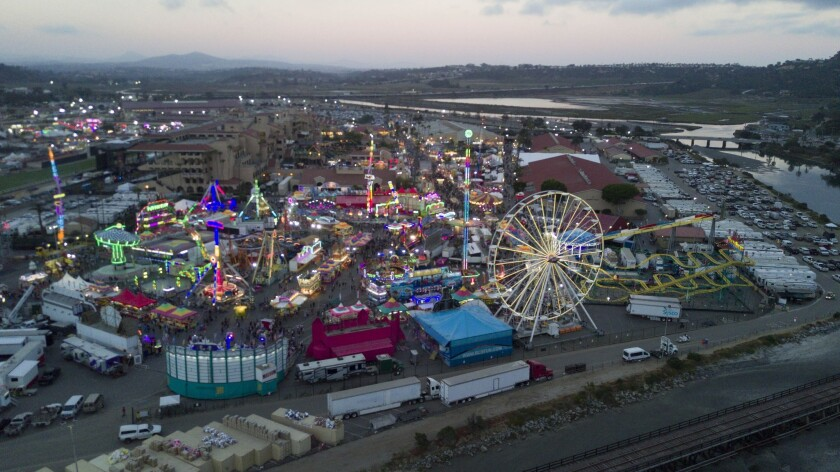 File photo: Lights of the Midway at the Del Mar fair are a rainbow of colors as the sun goes down as seen from outside the fair grounds on Pacific Coast Highway in 2017.