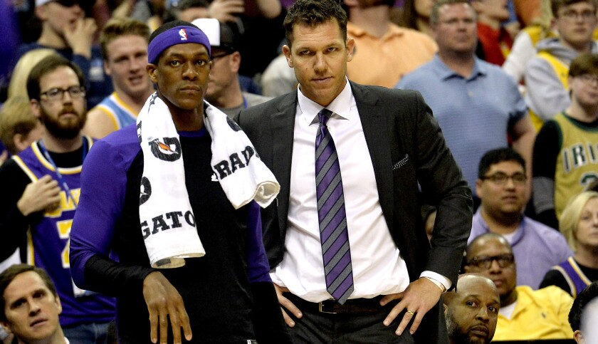 Los Angeles Lakers guard Rajon Rondo, left, and head coach Luke Walton look on from the sideline in