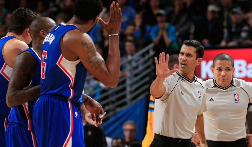 Referee Zach Zarba (28) directs Clippers players to their bench after center DeAndre Jordan (6) was called for a flagrant foul against Nuggets forward Kenneth Faried (not pictured) during their game Friday night in Denver.