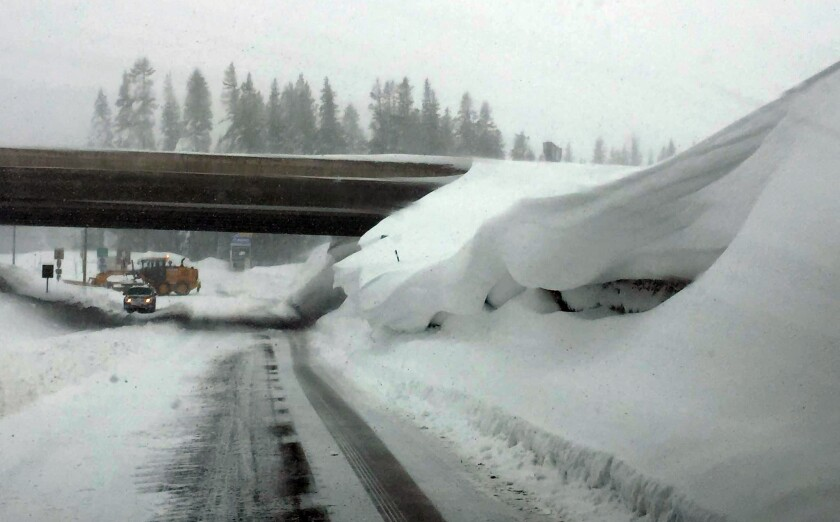 The Donner Pass Snowfighters work to clear Interstate 80 in Nevada County on Sunday.