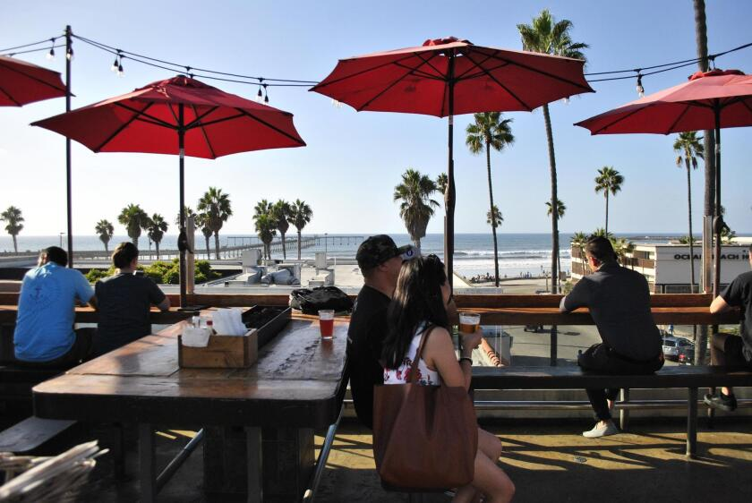 OB Brewery's spacious rooftop deck offers 360 degree views of Ocean Beach.