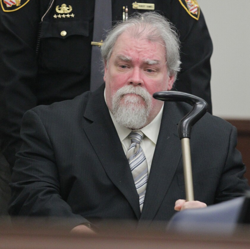 Richard J. Beasley, the alleged mastermind of a deadly plot to lure robbery victims with phony Craigslist job offers, is wheeled into court for the start of the jury selection process in his trial on Tuesday in Akron, Ohio.