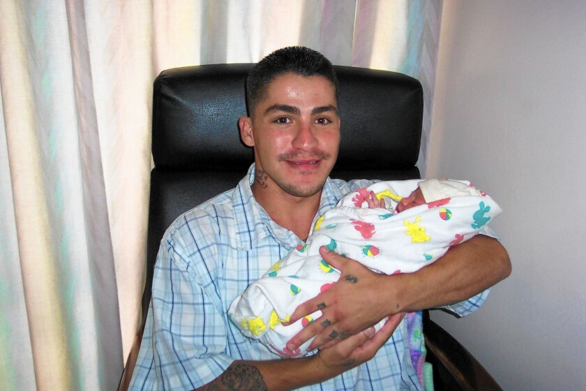 Ryan Gonzalez, shown with a niece, was shot and killed by an off-duty deputy U.S. marshal in 2008 after an altercation in an alley off Melrose Avenue in Los Angeles.