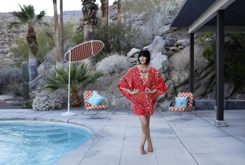 Trina Turk, wearing one of her own designs, is pictured at her home in Palm Springs. The desert city inspired her new summer line for Banana Republic.