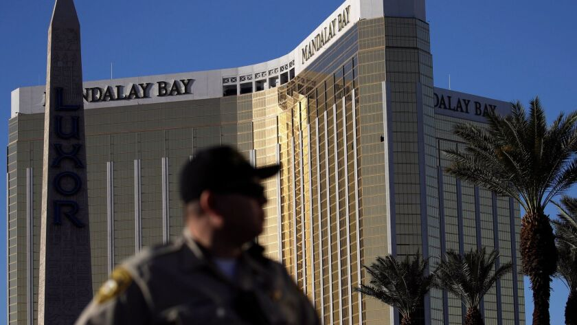 FILE - In this Tuesday, Oct. 3, 2017 file photo, a Las Vegas police officer stands by a blocked off