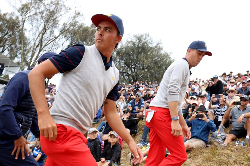 Rickie Fowler and Justin Thomas of the United States team walk on the fourth hole during Saturday's four-ball matches on Day 3 of the Presidents Cup at Royal Melbourne Golf Course on Dec. 14.