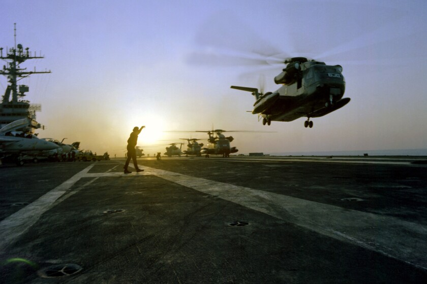 "A helicopter takes off from an aircraft carrier in an archival photo from the documentary ""Desert One."""