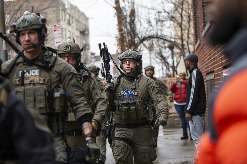 Police arrive at the scene Tuesday in Jersey City, N.J.