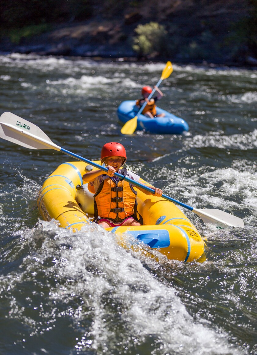 A one-person kayak, shown here on the Rogue River in Oregon, makes social distancing possible on a rafting trip.